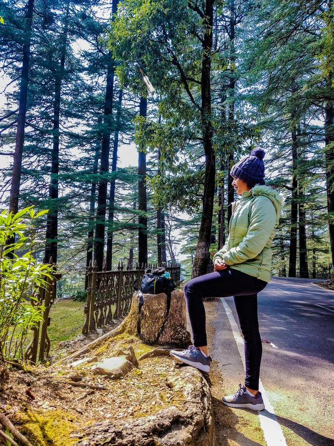 A girl standing on the trekking path