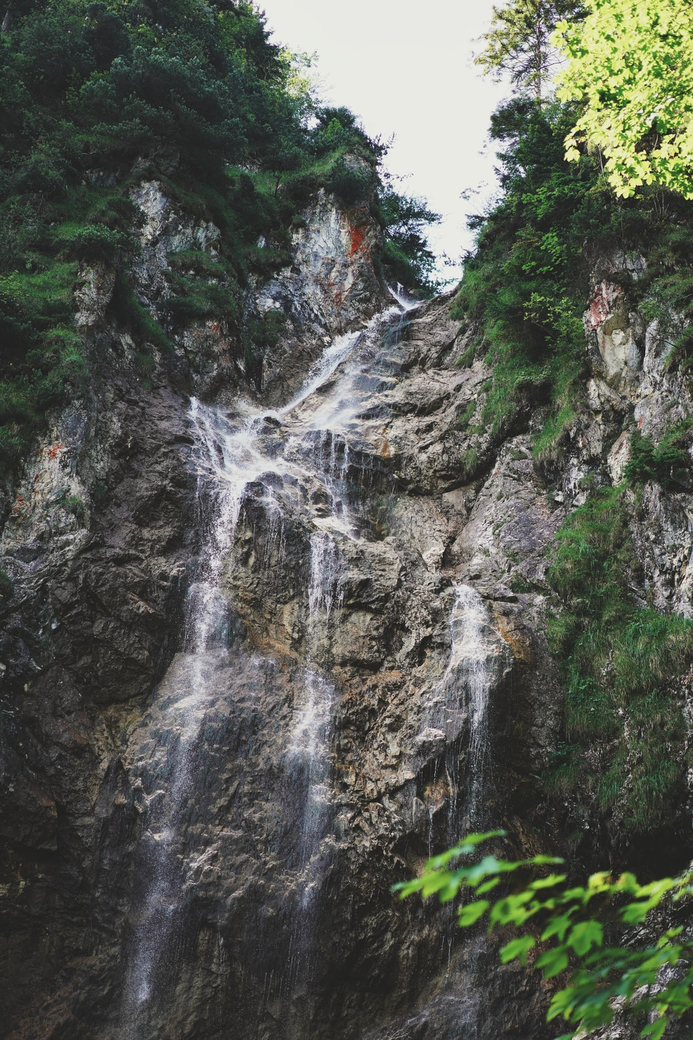 waterfalls in the middle of rocky mountain