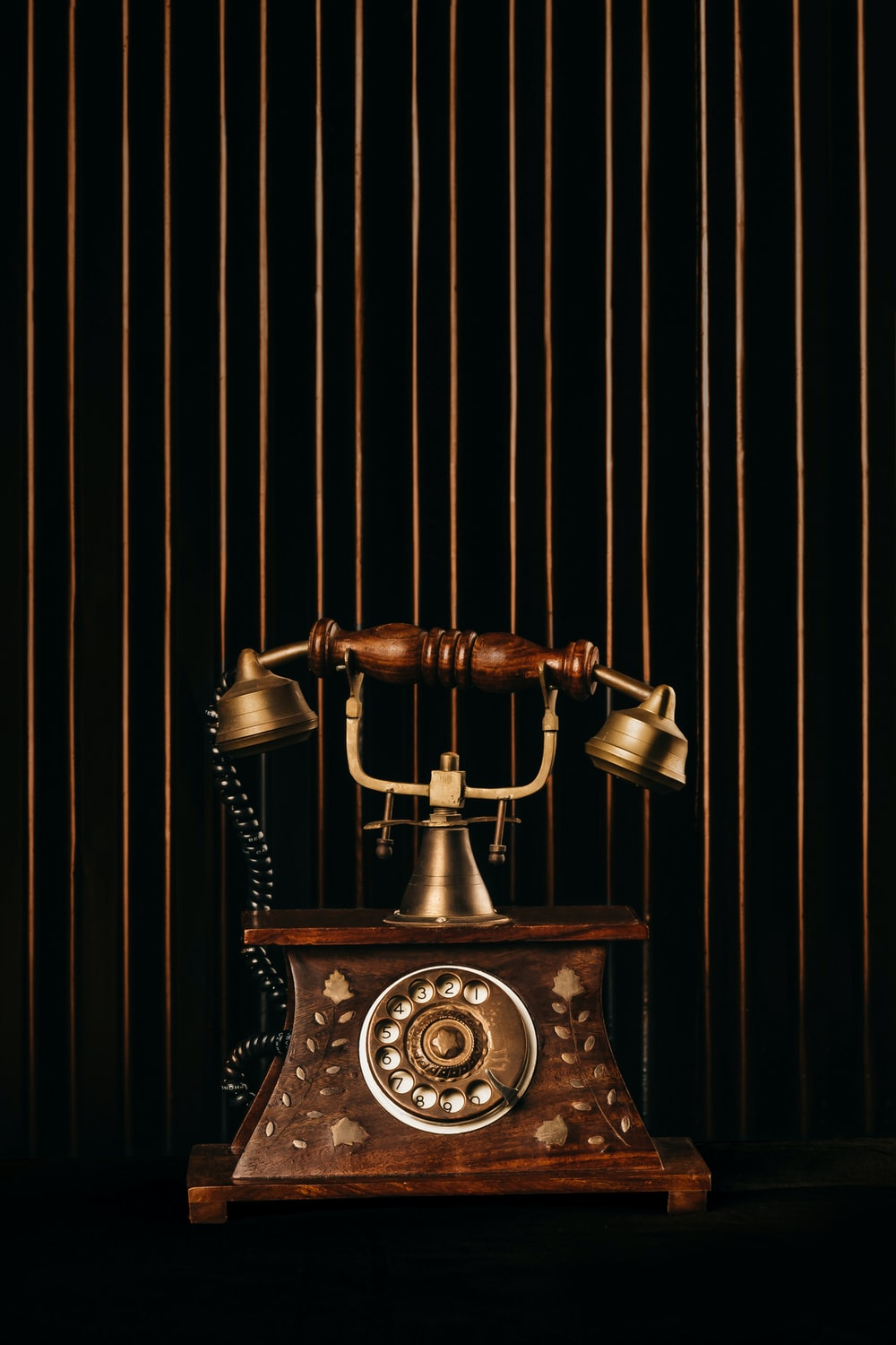 black and gold rotary phone