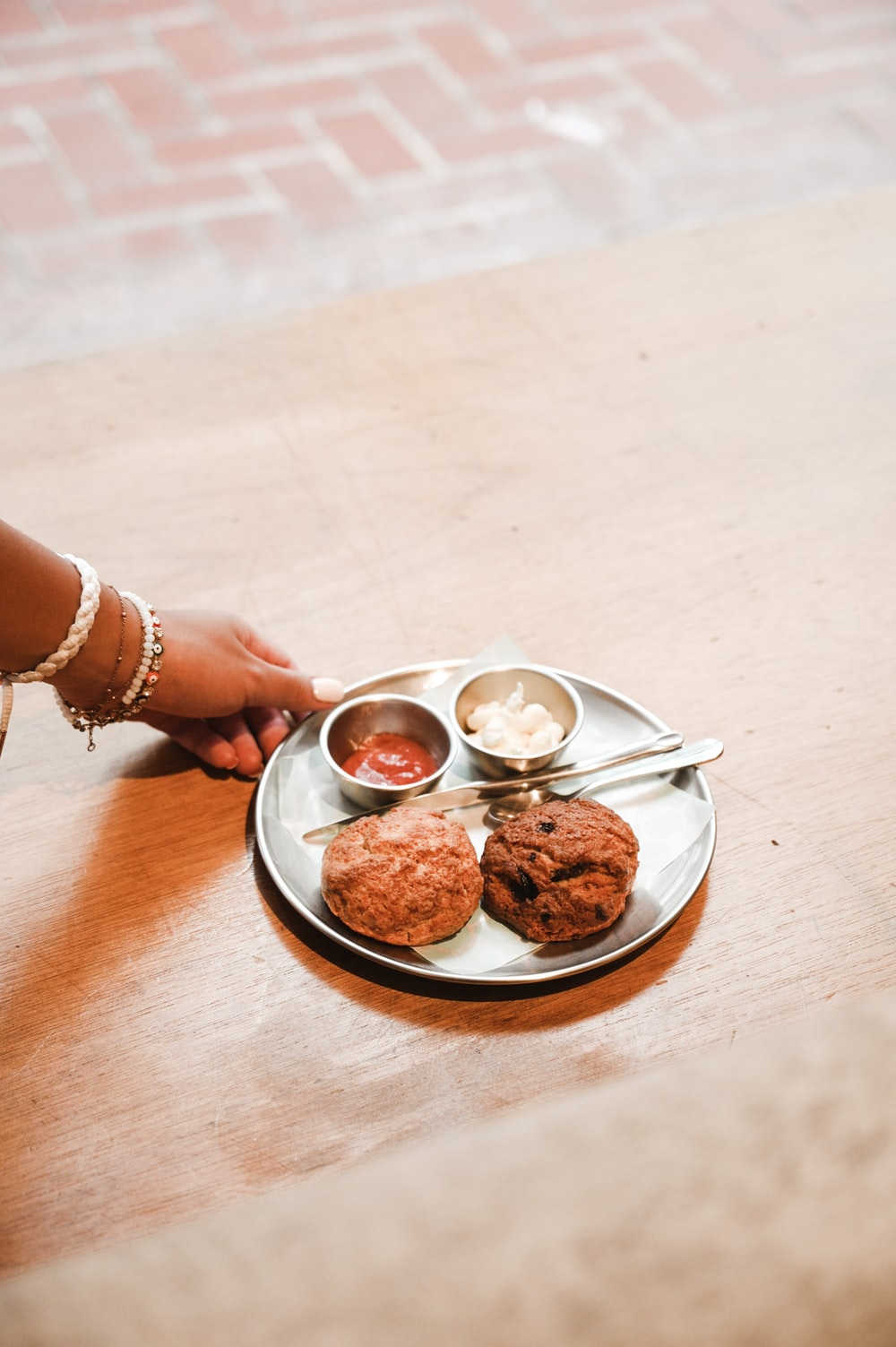 person holding white ceramic bowl with food
