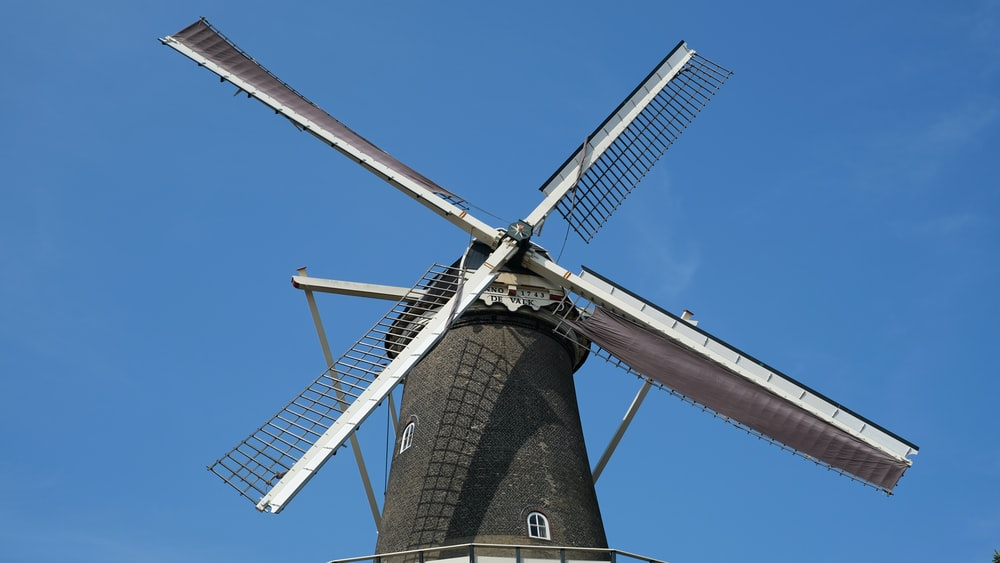 black and white windmill under blue sky during daytime