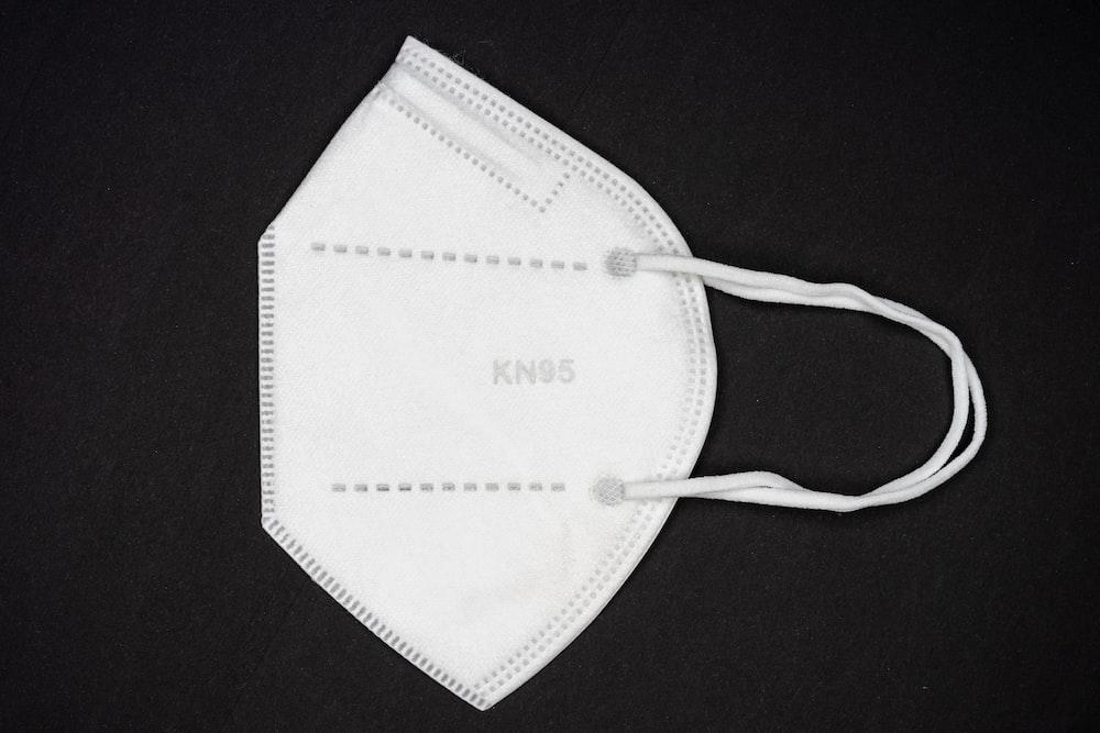 white paper on black textile