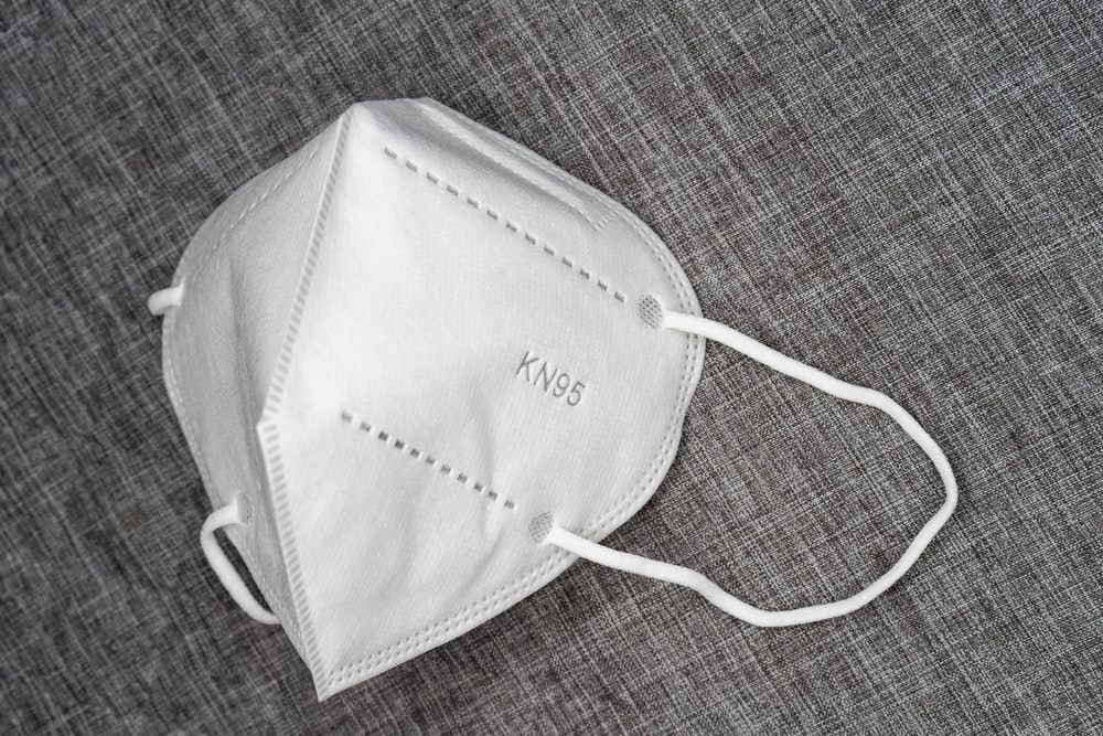 white leather sling bag on brown textile