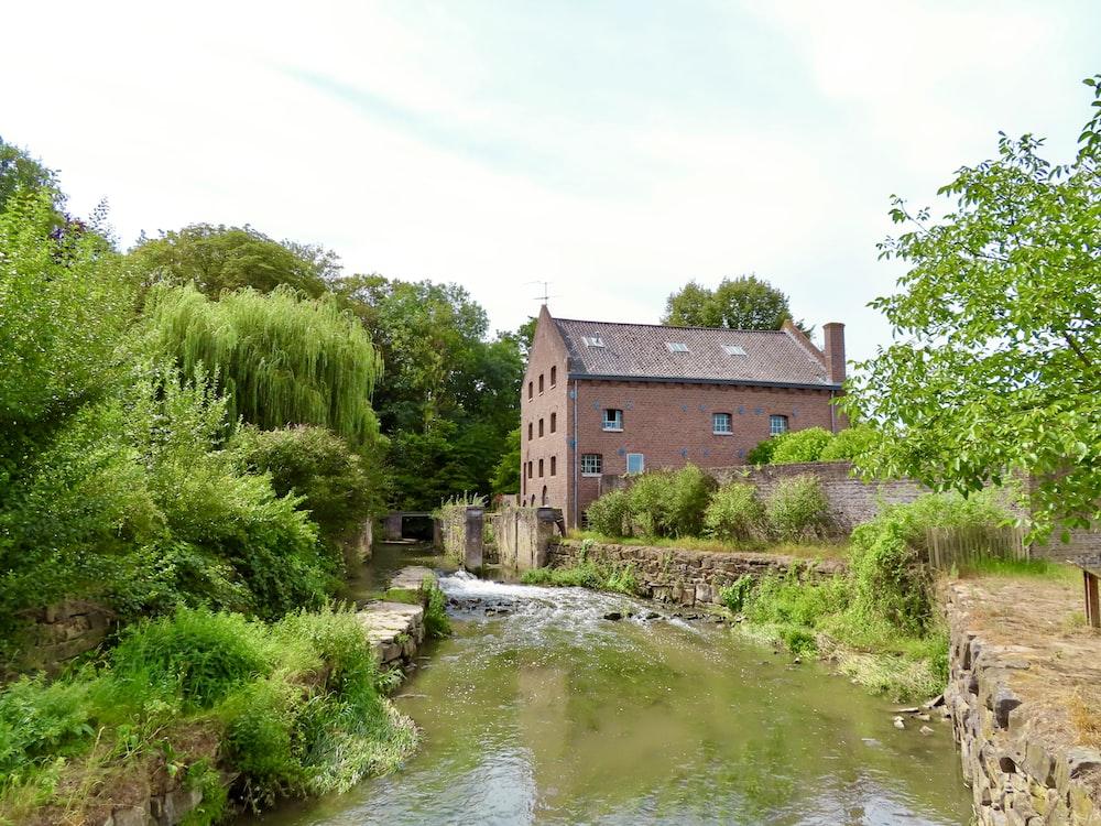 brown brick building beside river