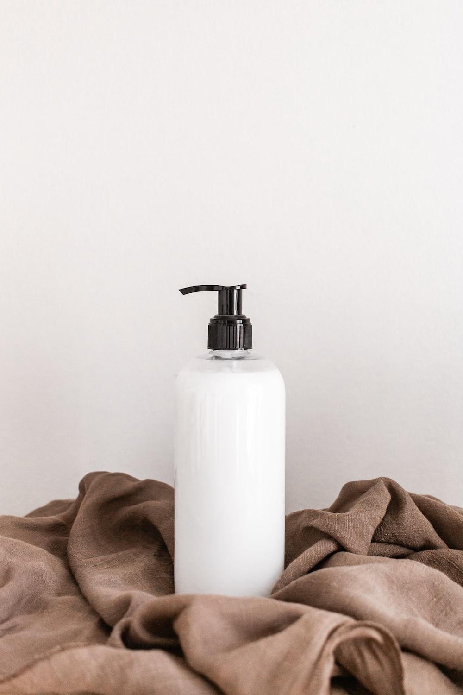 white plastic bottle on white table