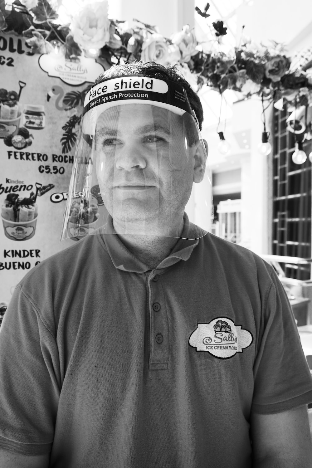 man in black polo shirt wearing black and white fitted cap