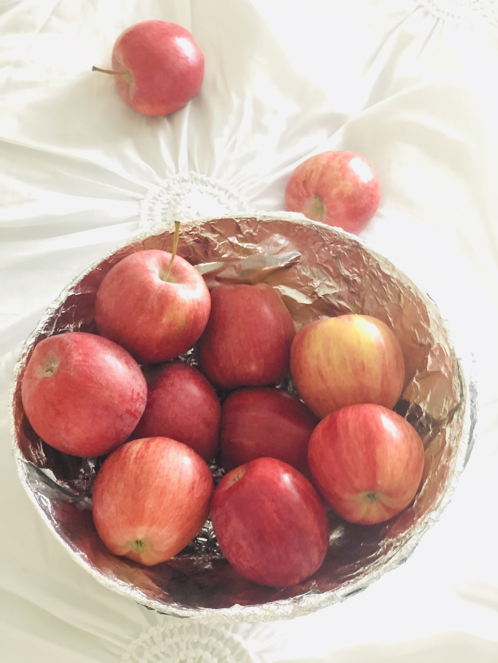 red round fruits on brown woven basket