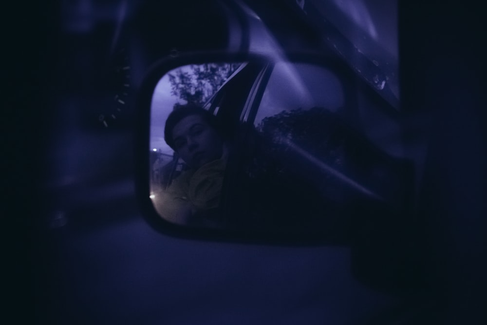 man in black sunglasses taking selfie in car