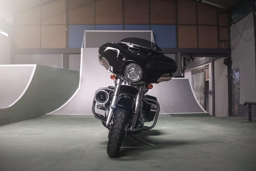 black motorcycle parked in garage