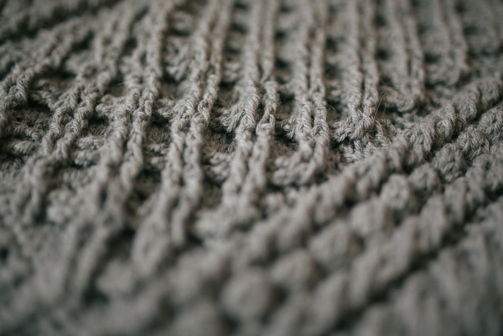 gray knit textile in close up photography