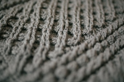 gray knit textile in close up photography knitting zoom background