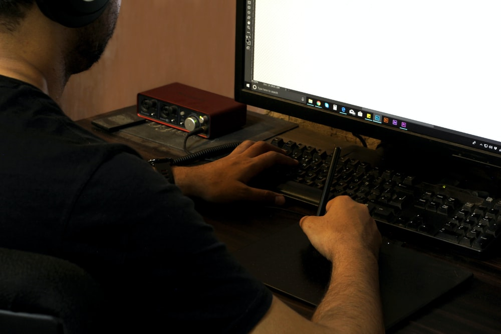 person in black long sleeve shirt using computer