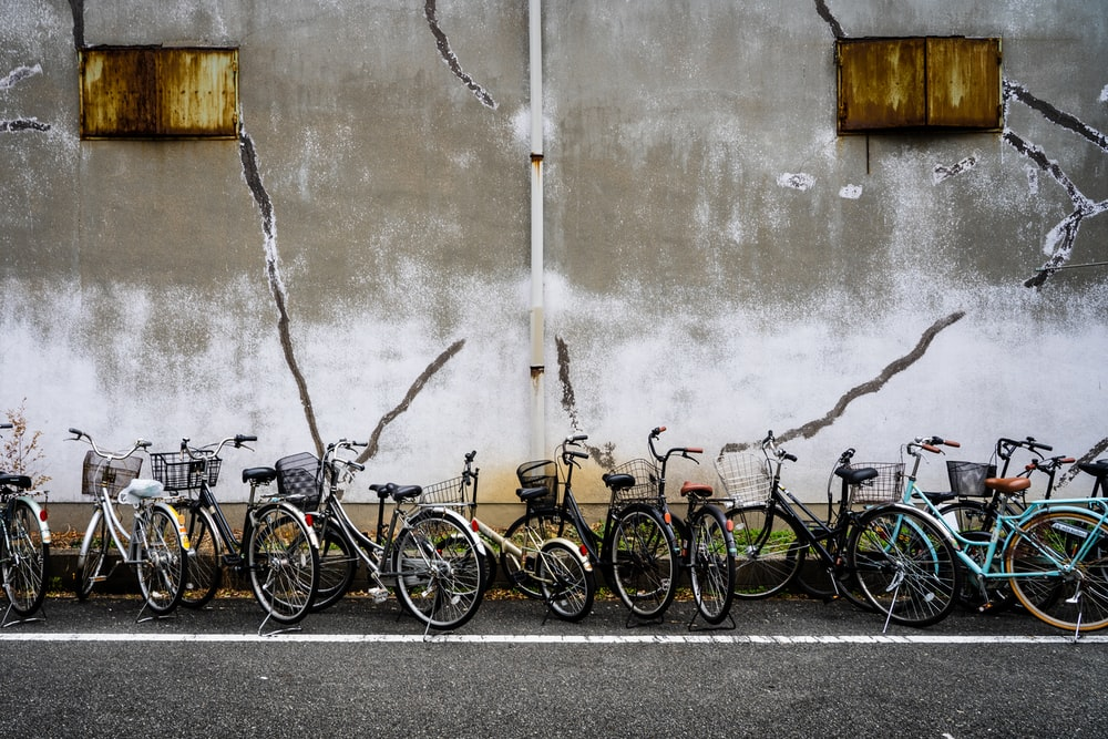 black and brown bicycles on gray concrete road