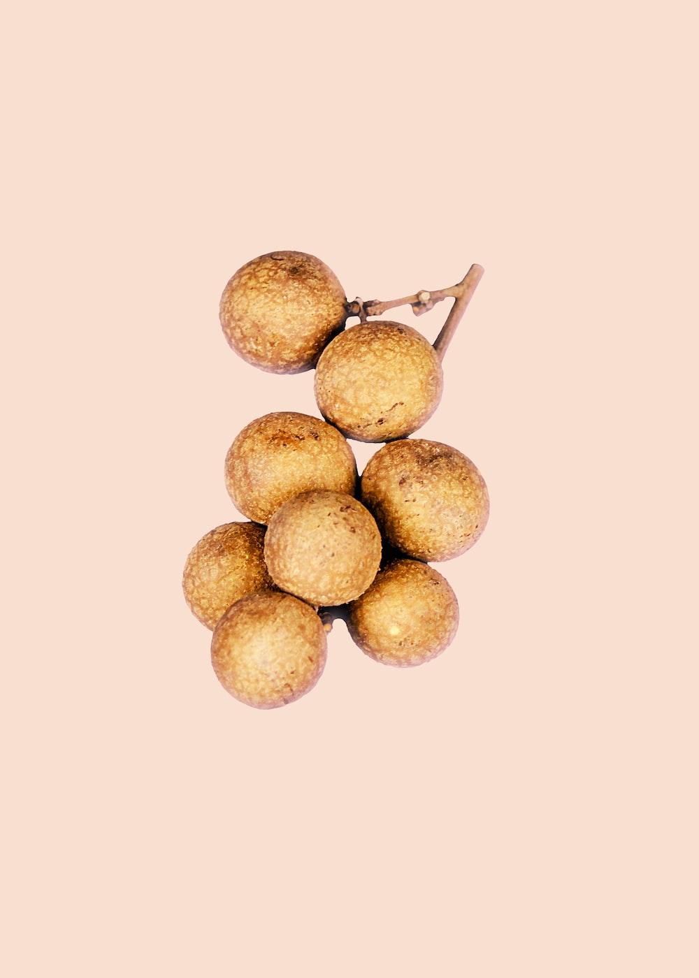 brown round fruit on white background