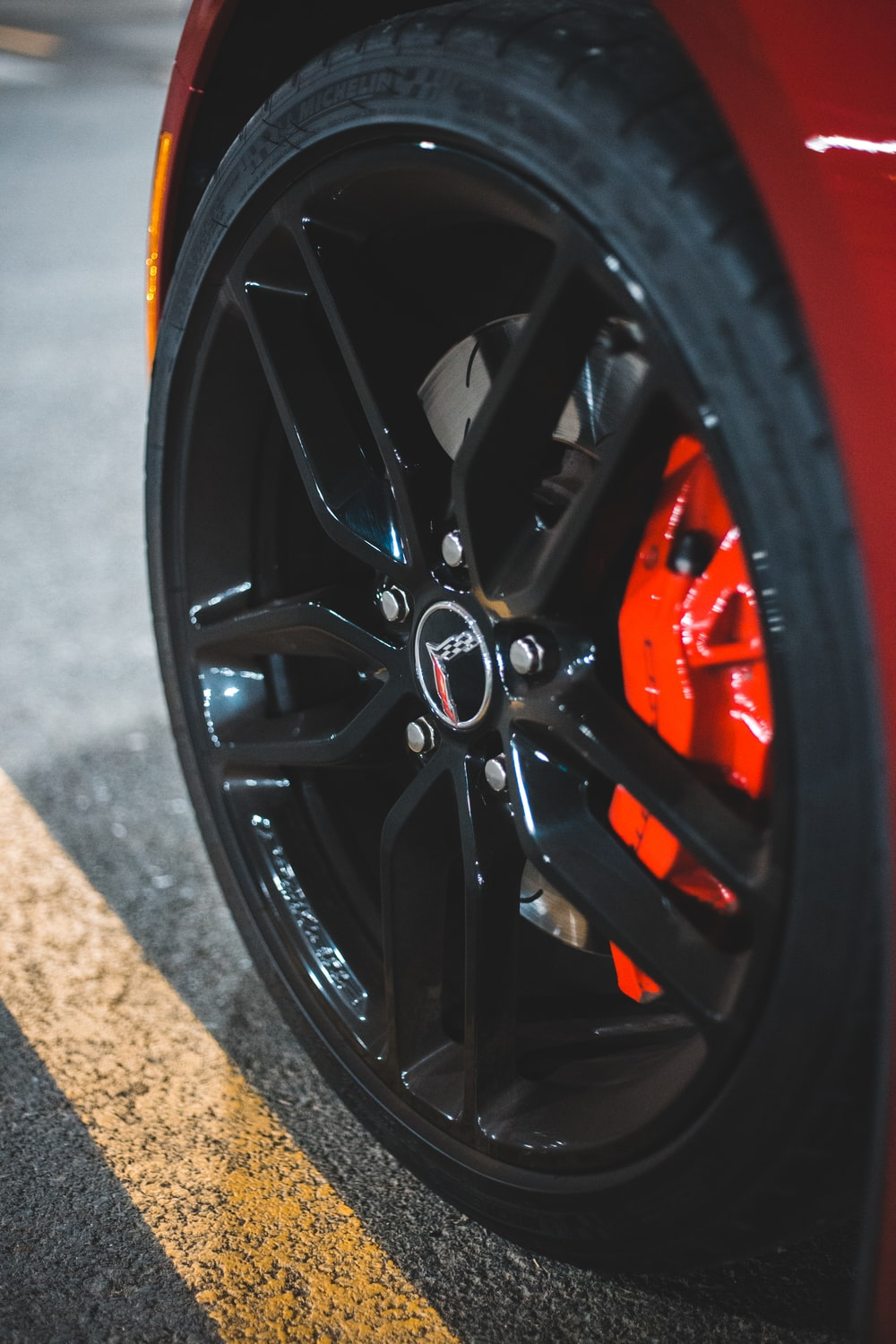 black and red wheel on brown concrete floor