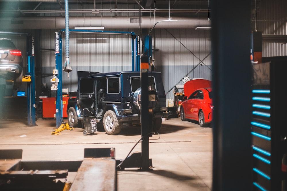 black suv in a garage
