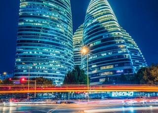 green and blue lighted building during night time