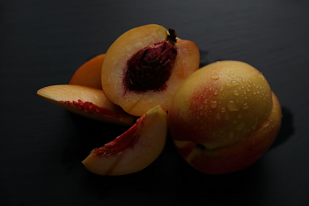 two red and yellow fruits