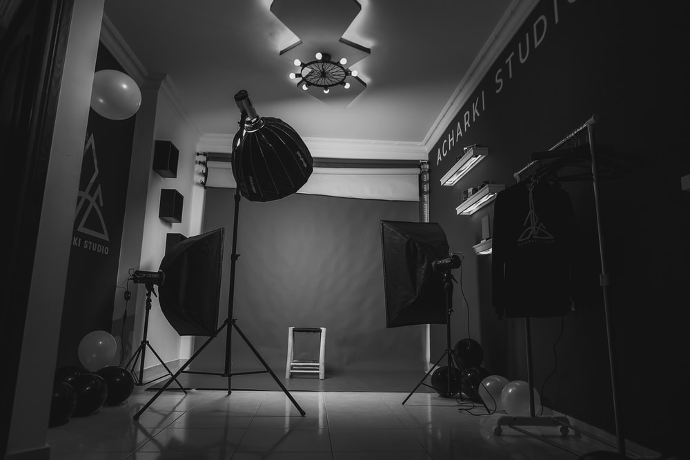 grayscale photo of music stand with drum kit