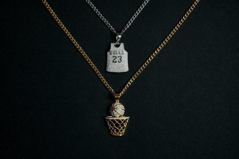 silver heart pendant necklace on black textile