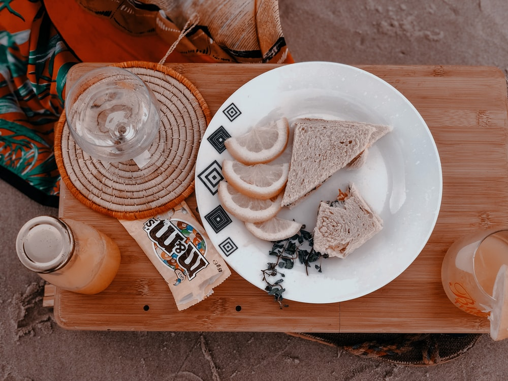 white ceramic plate with sliced bread