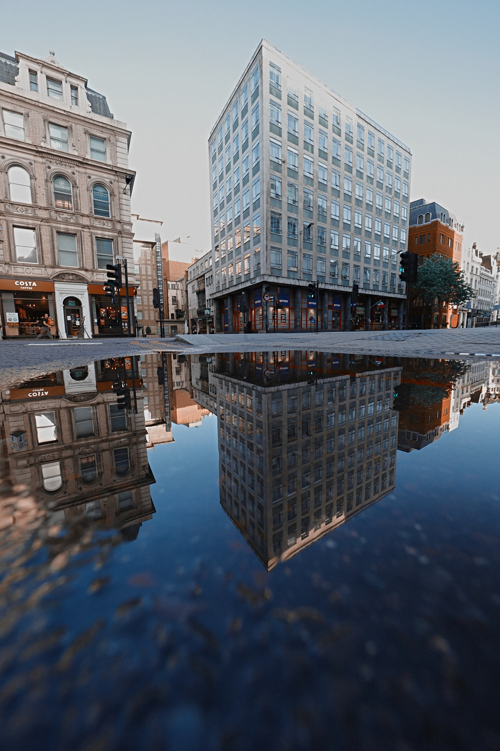 reflection of building on water during daytime