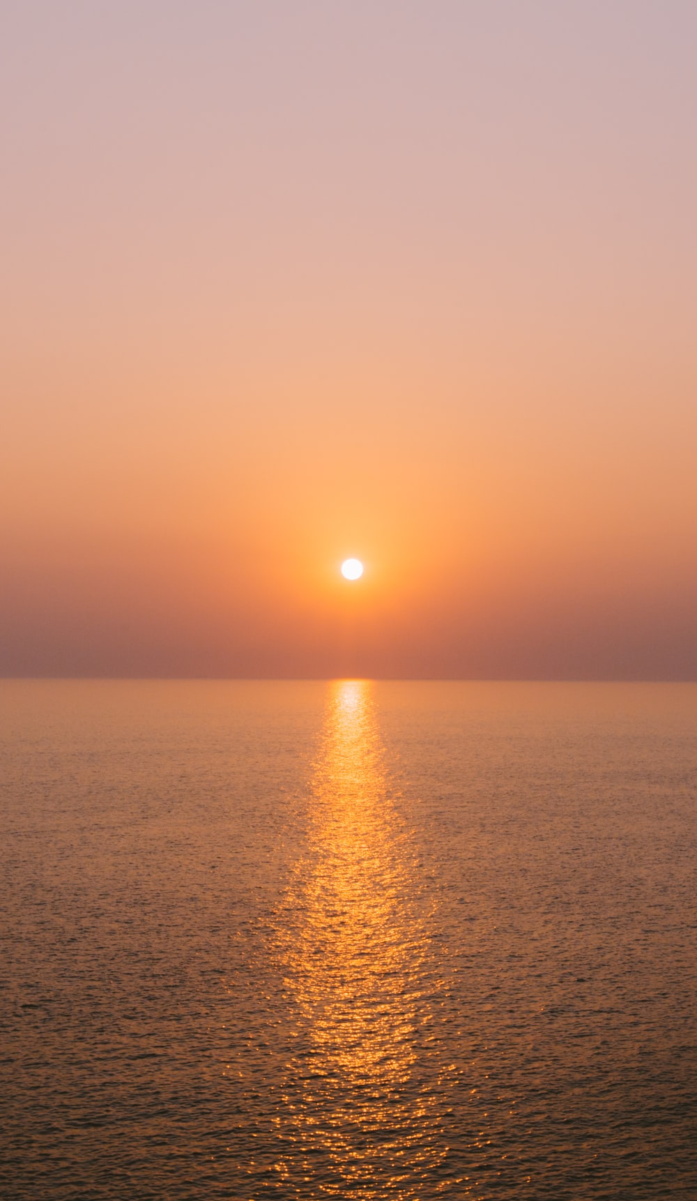 sun setting over the sea