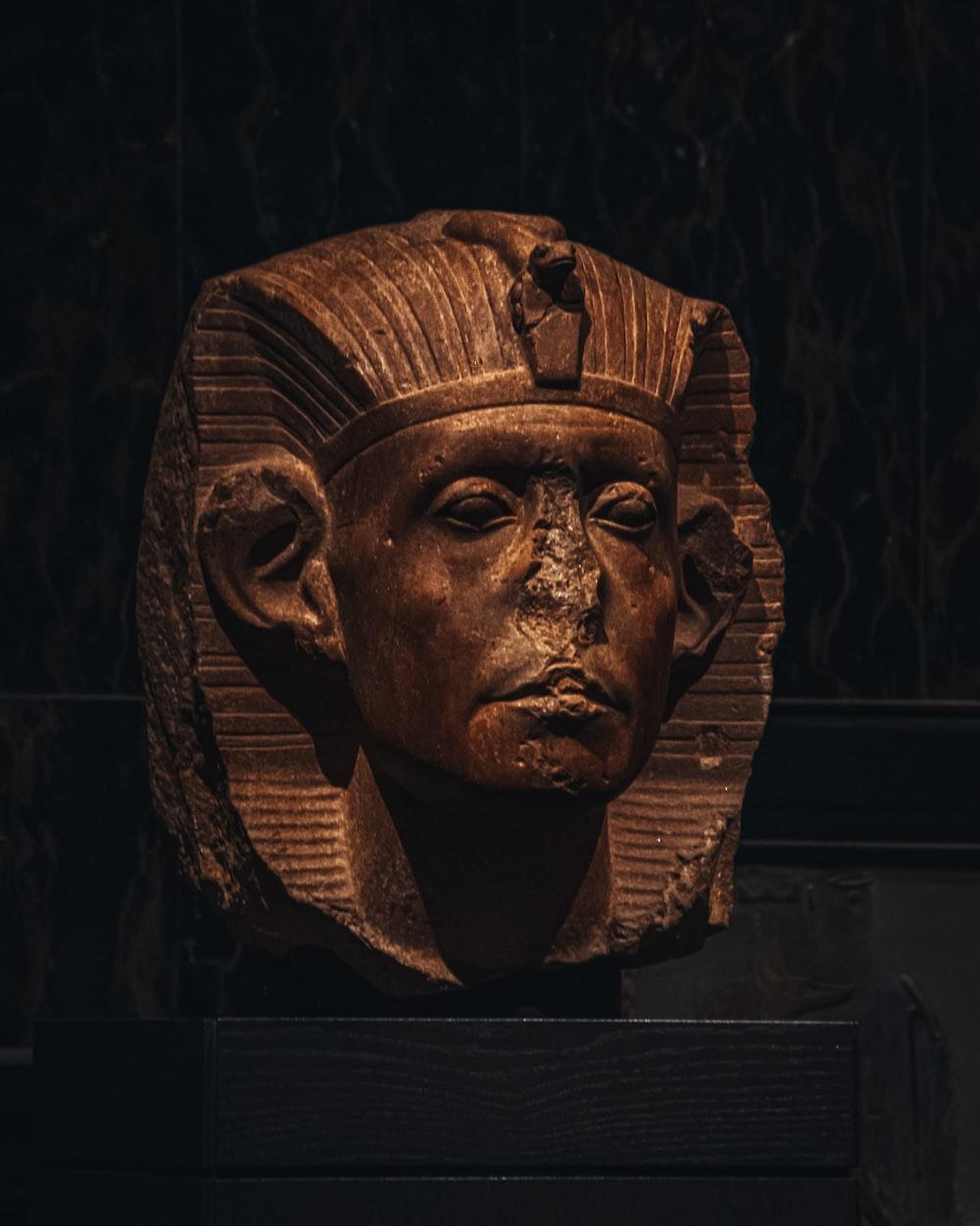 brown wooden mans face carved