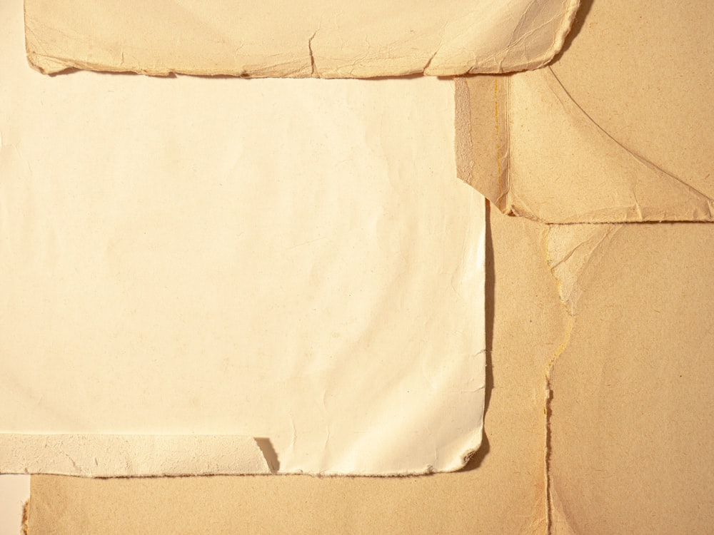white printer paper on brown textile