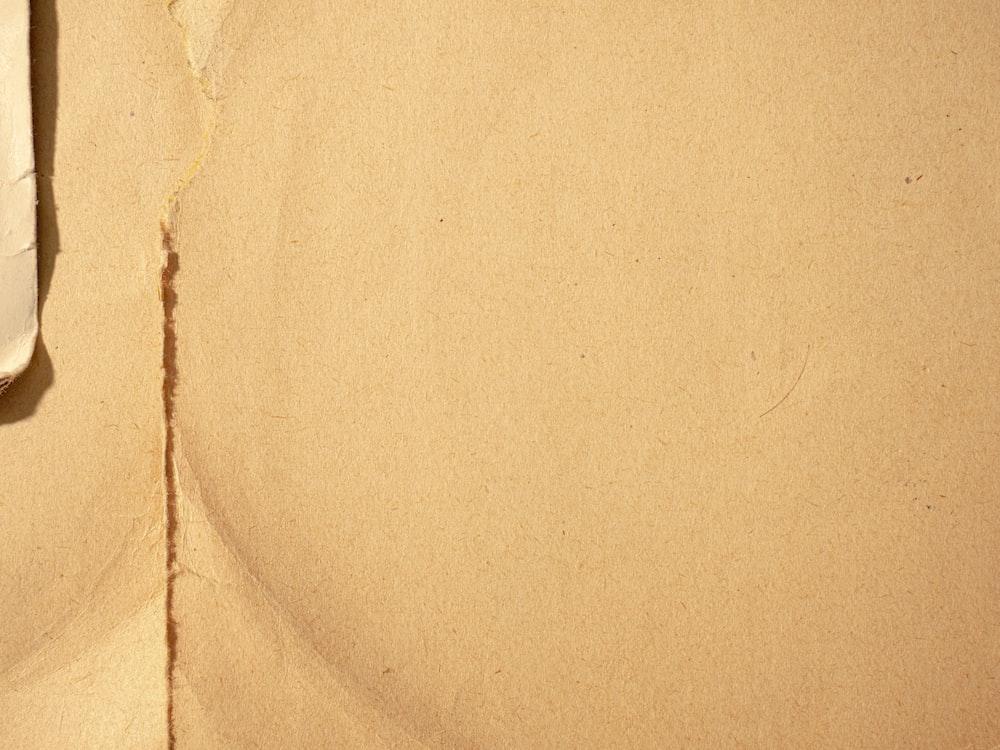 white textile on brown textile