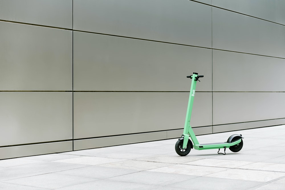 green and black kick scooter