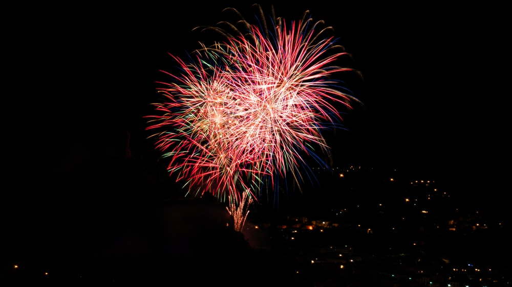 red and white fireworks display during night time