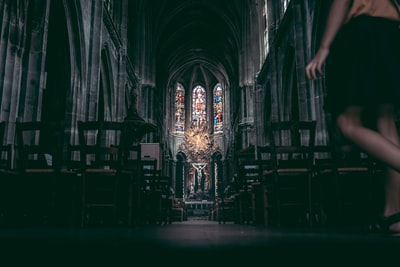 brown wooden chairs inside cathedral