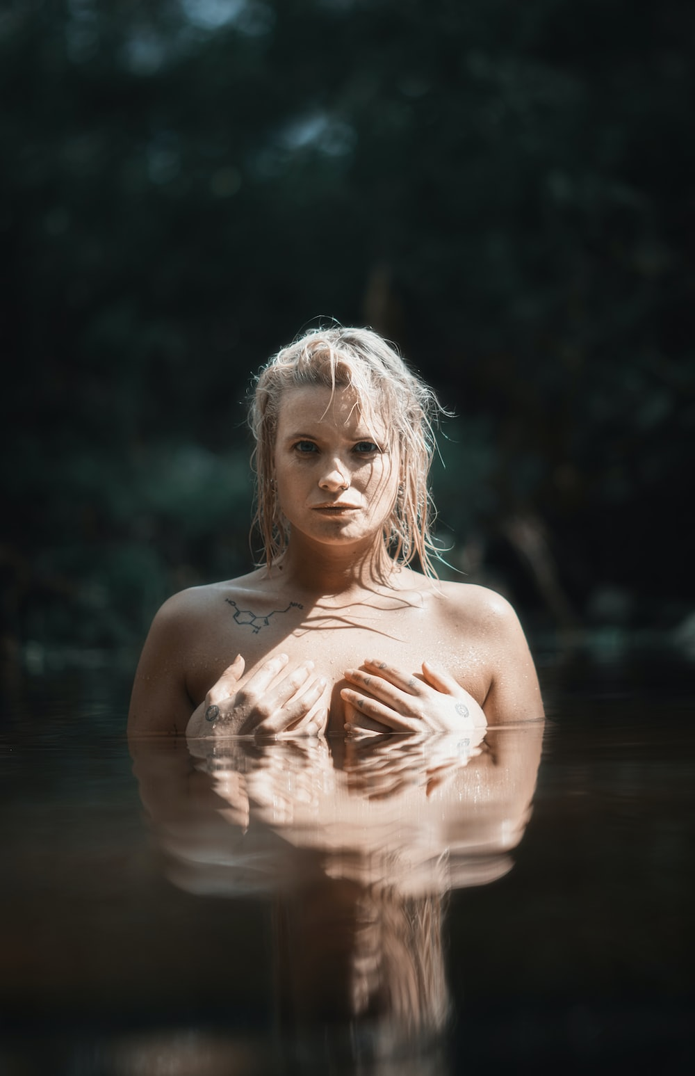 topless woman in water during daytime