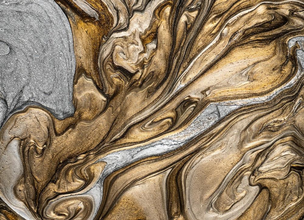 gray textile on brown textile