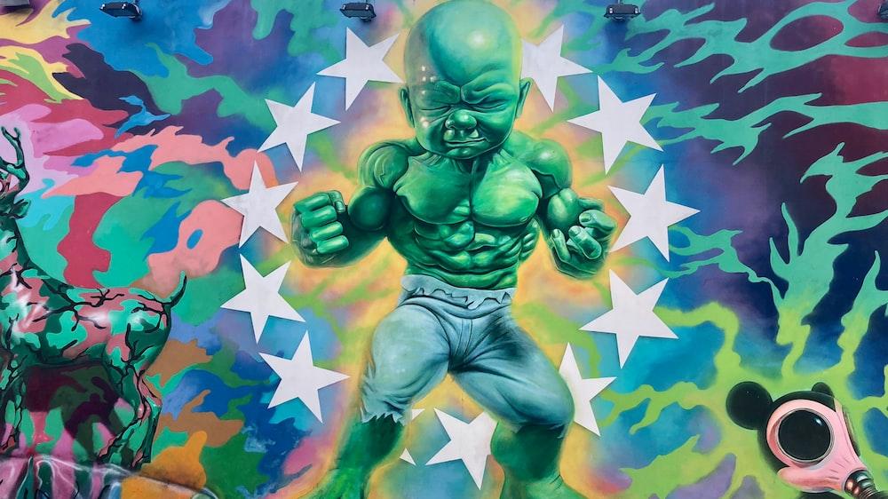 green and blue alien illustration