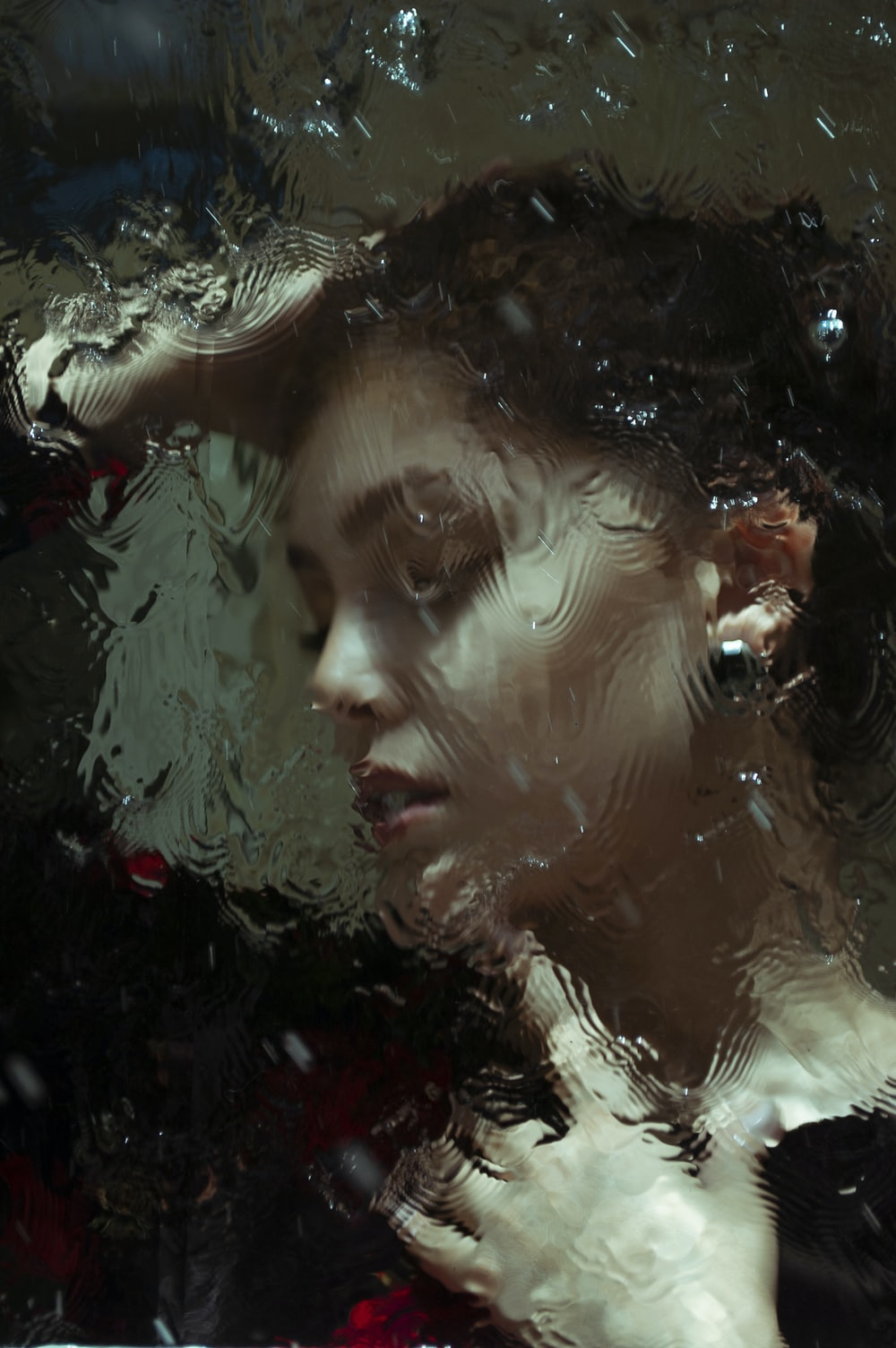 woman in water with water droplets