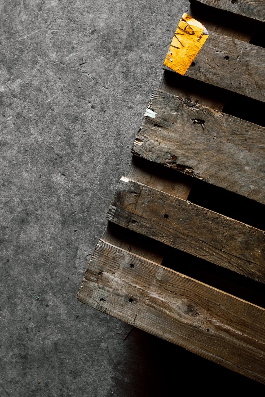 brown wooden pallet on gray concrete floor
