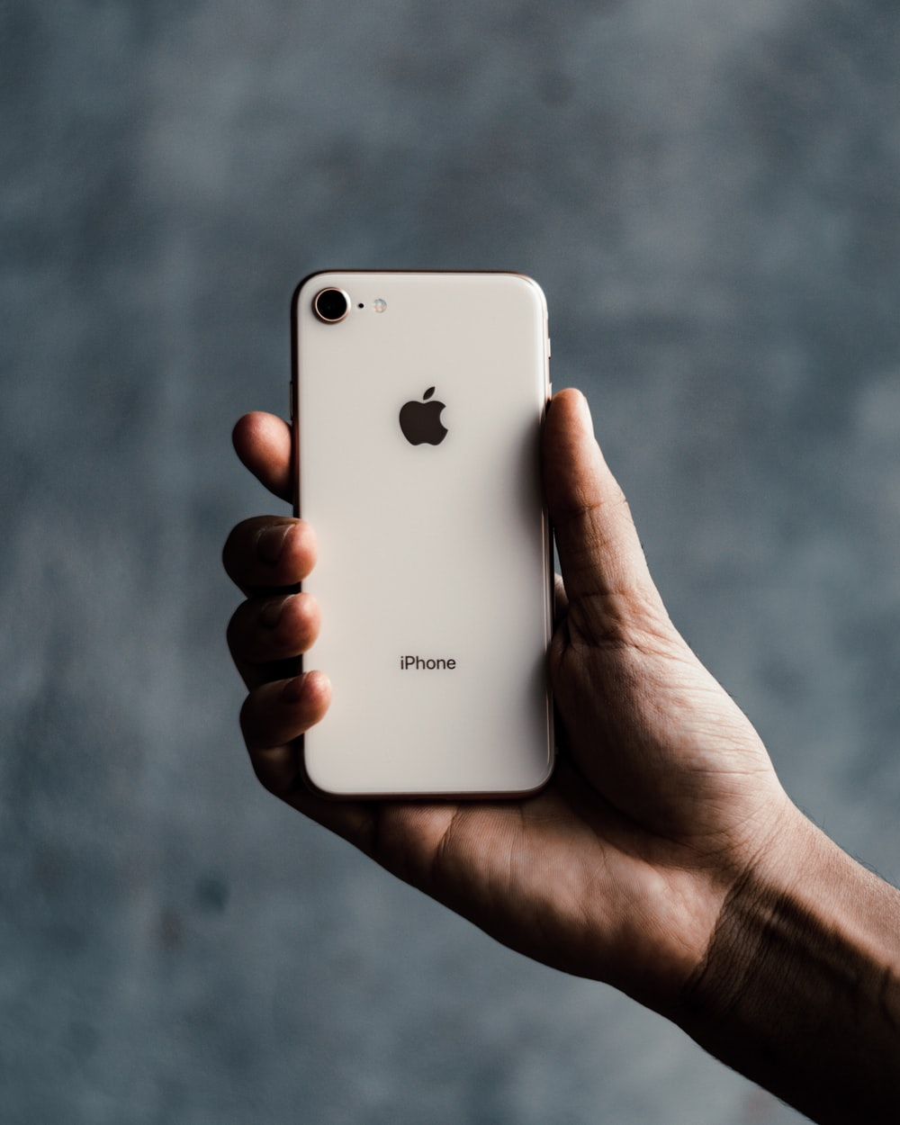 person holding white iphone 5 c