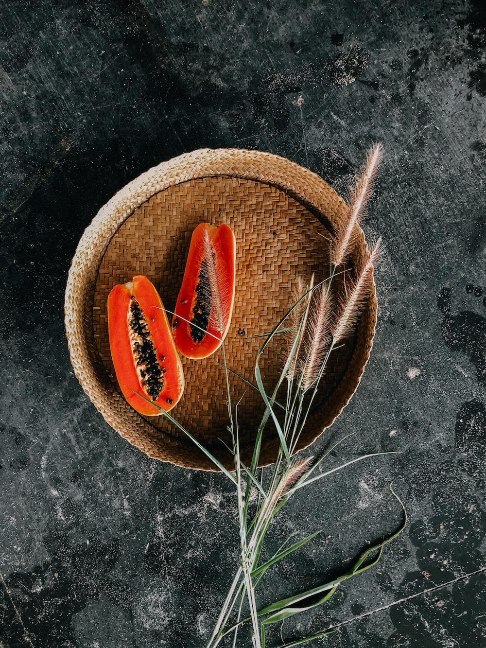 orange carrots on brown woven round basket