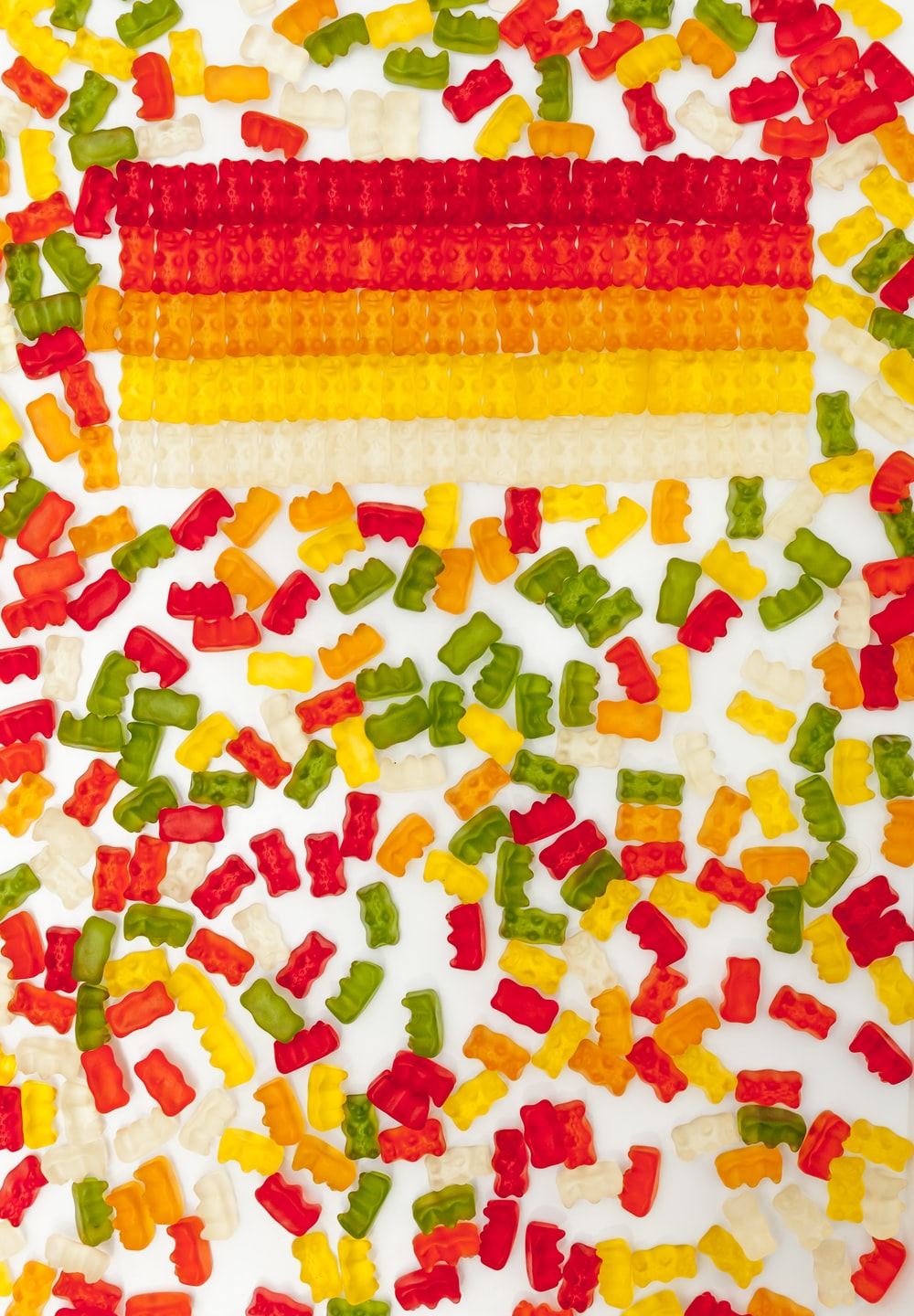 red yellow and white textile