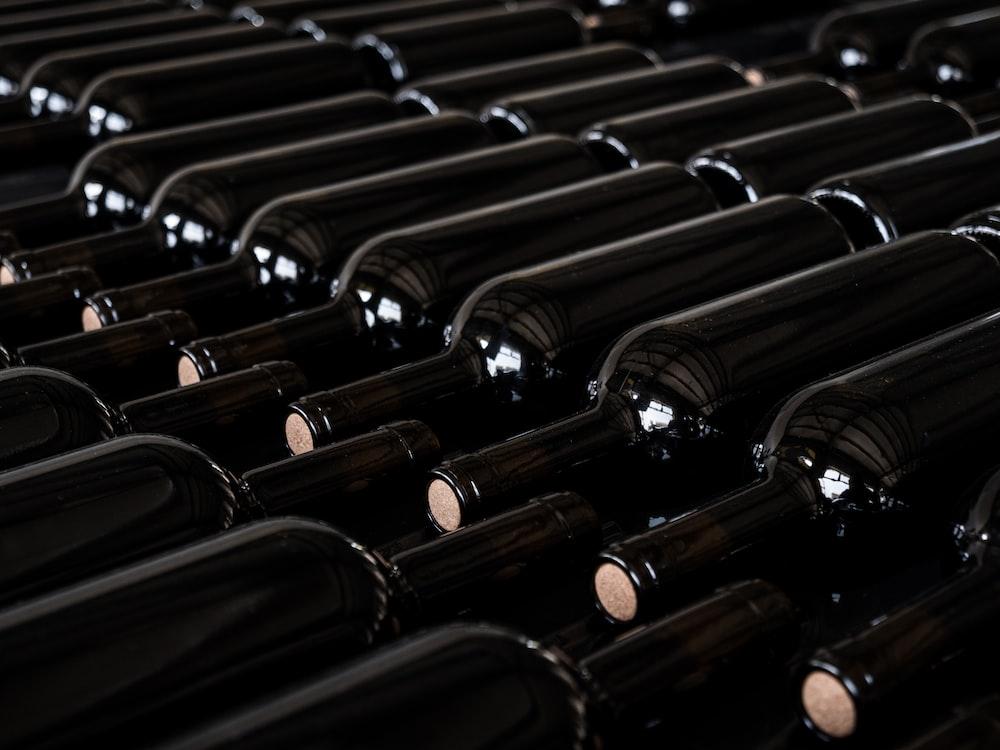 black bottles on black rack