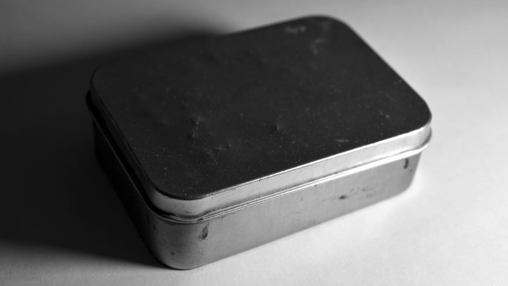 black and gray plastic container