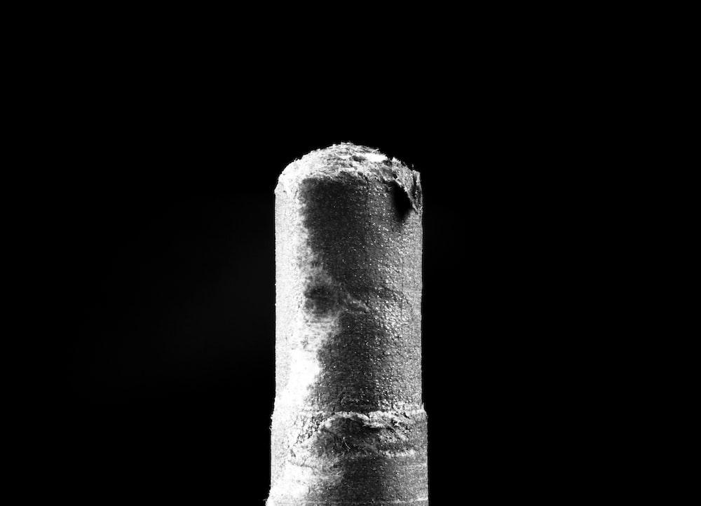 gray concrete pillar with white background