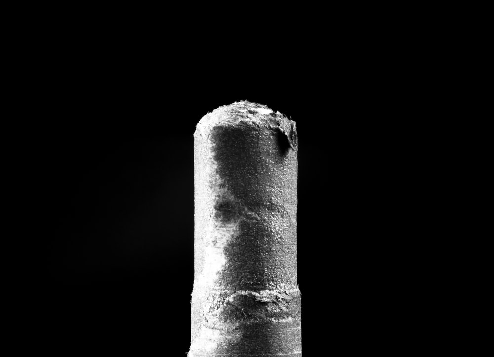 gray concrete pillar with white background