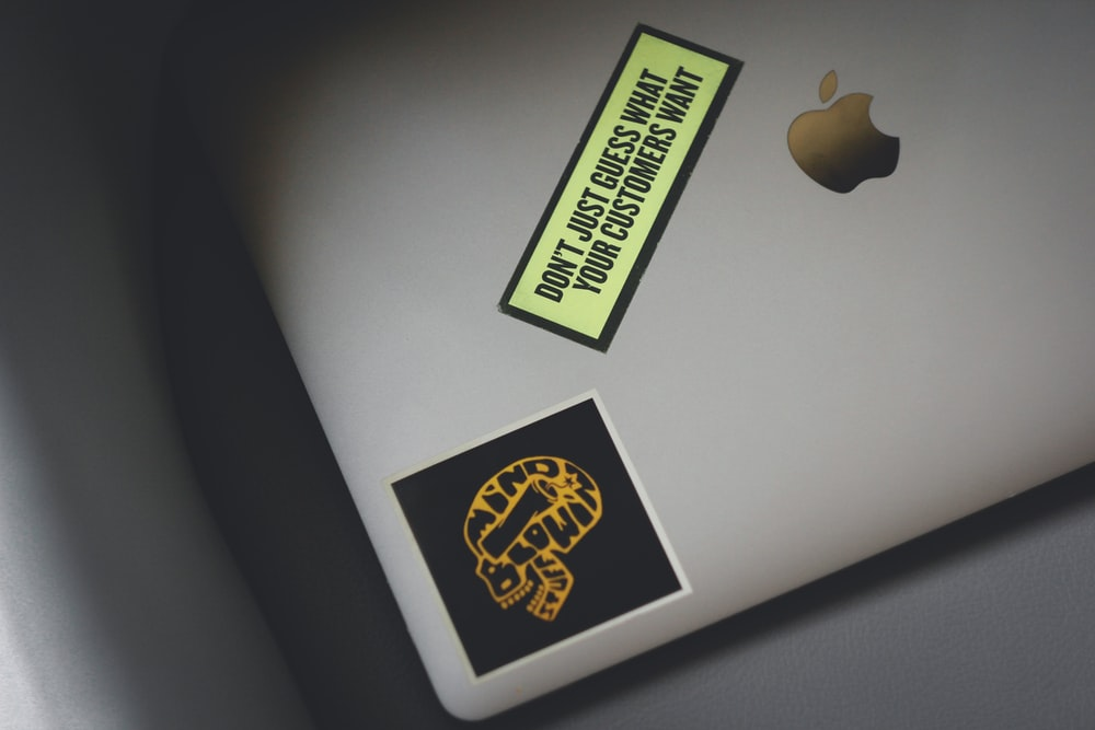macbook pro with yellow and black sticker
