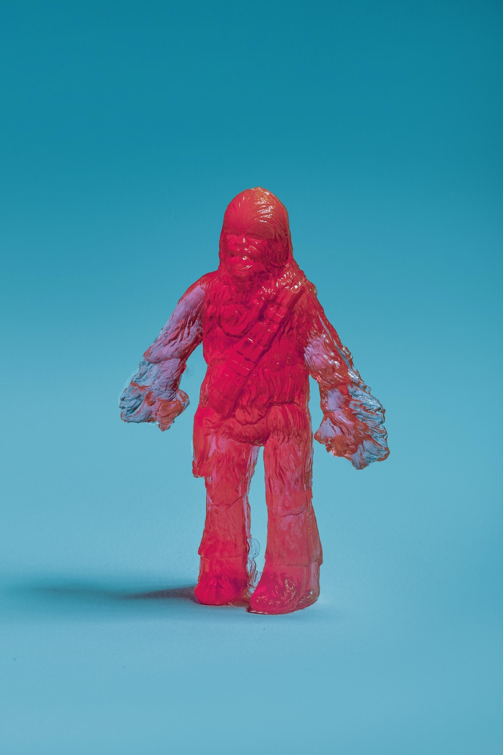 red human statue on blue background