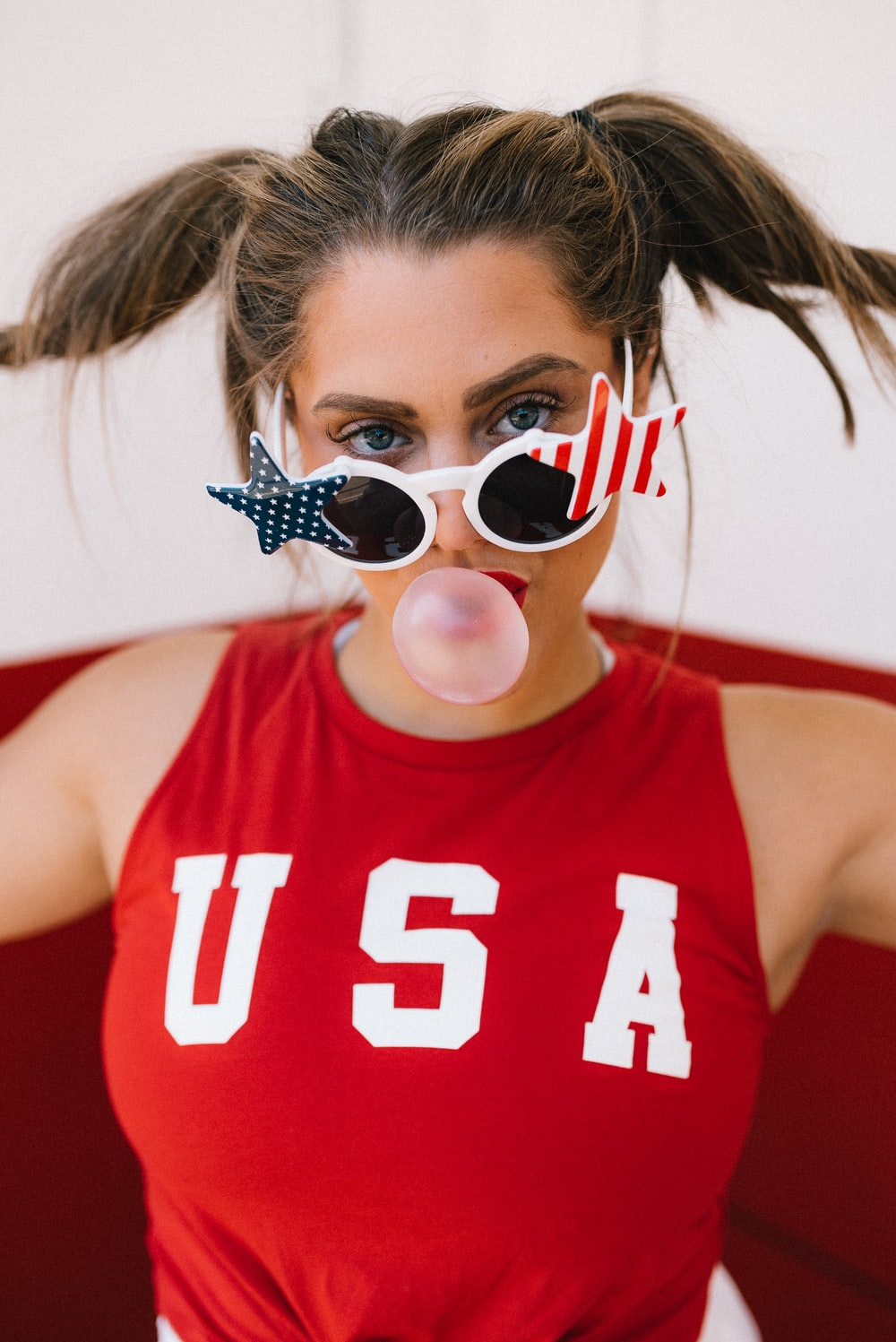 woman in red tank top wearing sunglasses
