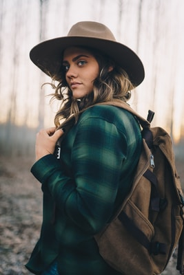 woman in green and black plaid long sleeve shirt wearing black hat