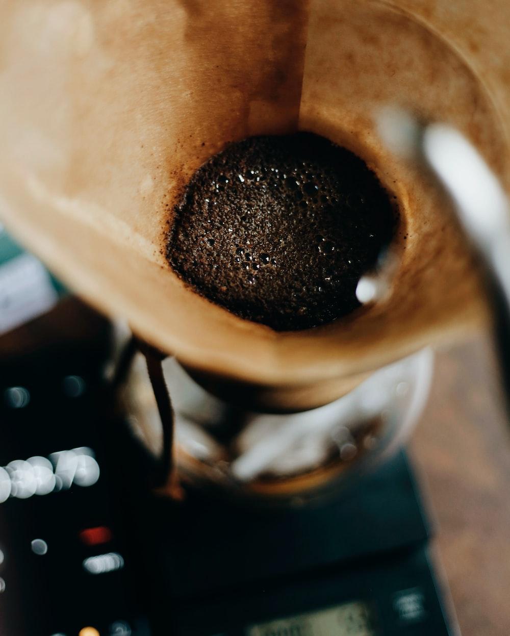 black powder on brown wooden bowl